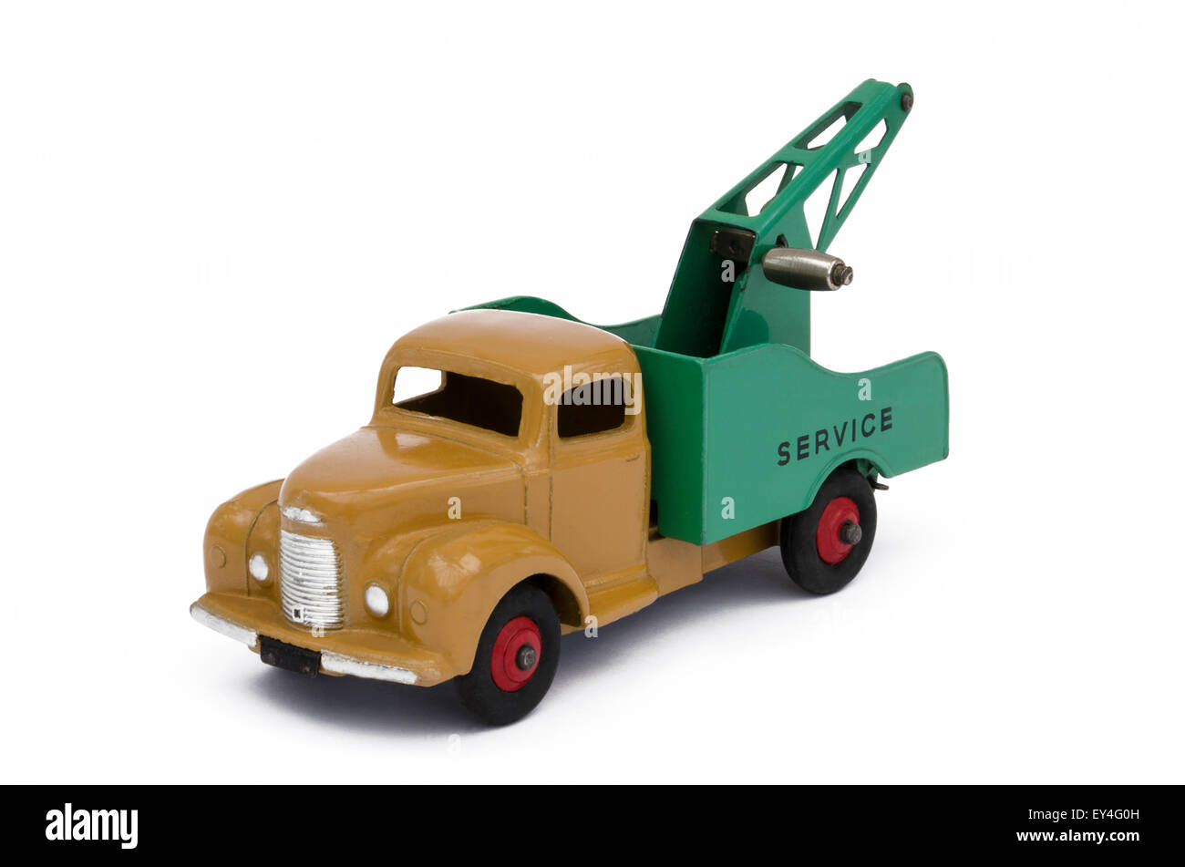 Vintage, brown and green toy towing truck. Isolated against a white background - Stock Image