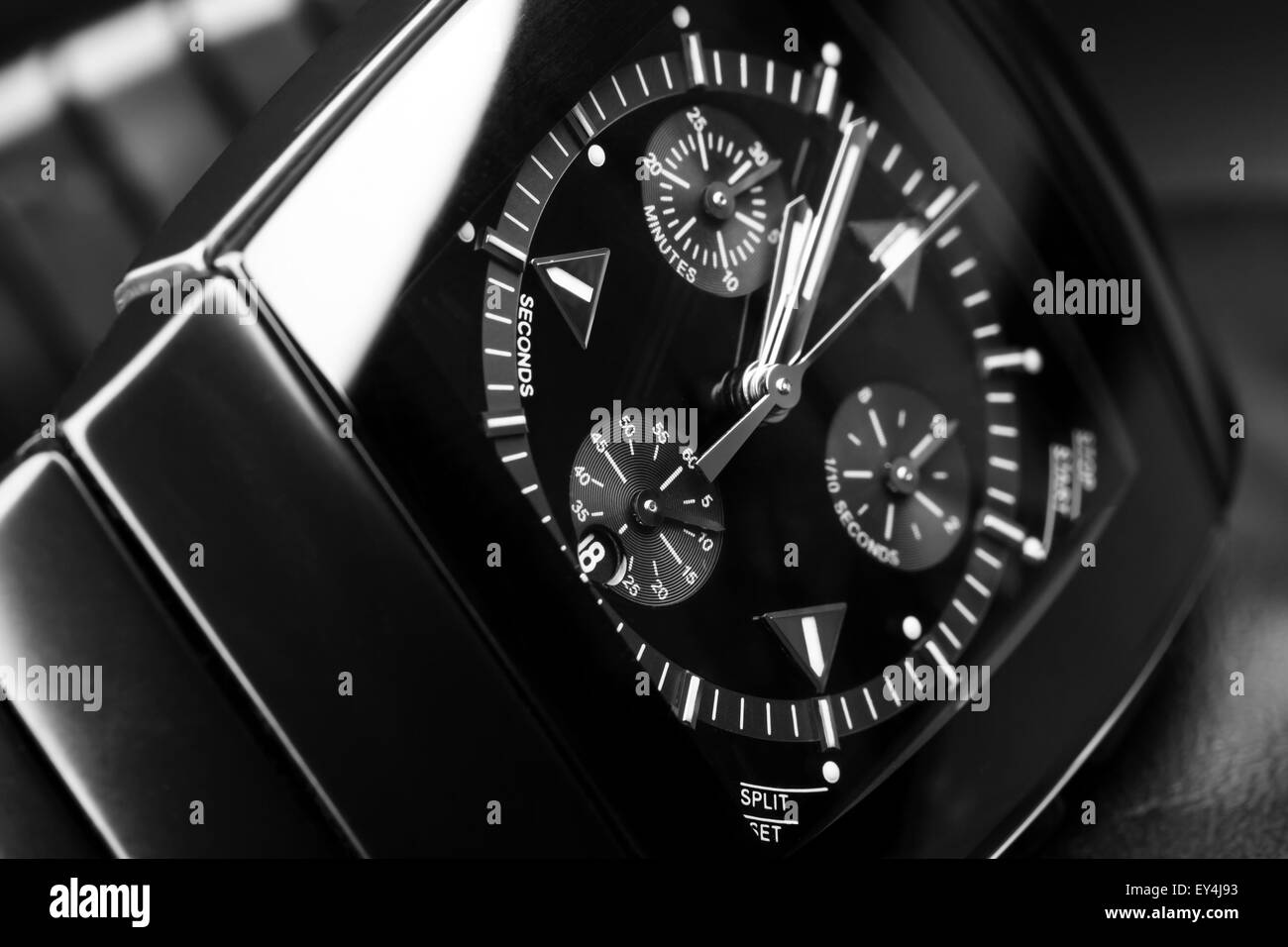 Luxury mens chronograph watch made of black high-tech ceramics. Close-up studio photo with selective focus - Stock Image