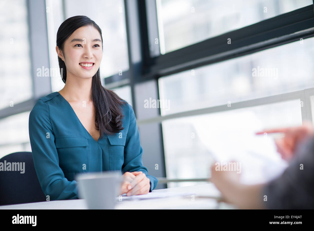 Young woman interviewing for a job - Stock Image