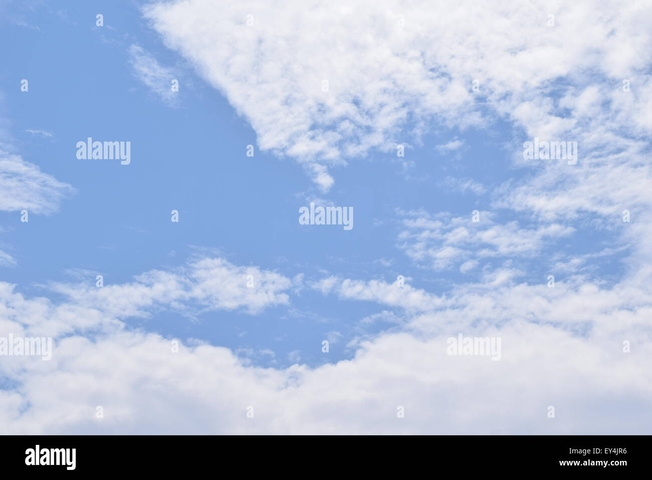 ordinary blue sky with some white clouds - Stock Image