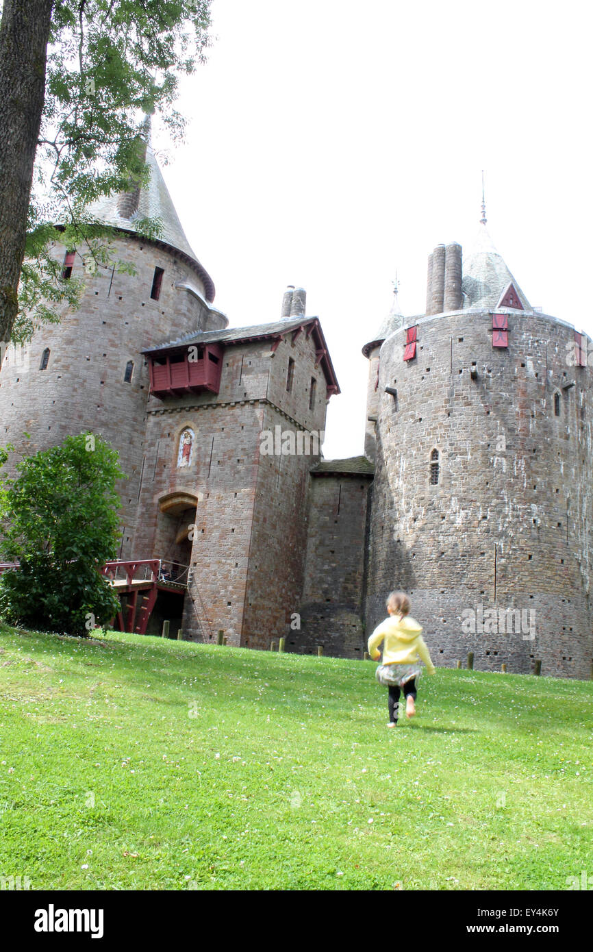 Young girl running towards castle or Castell Coch, Cardiff, South Wales, UK - Stock Image