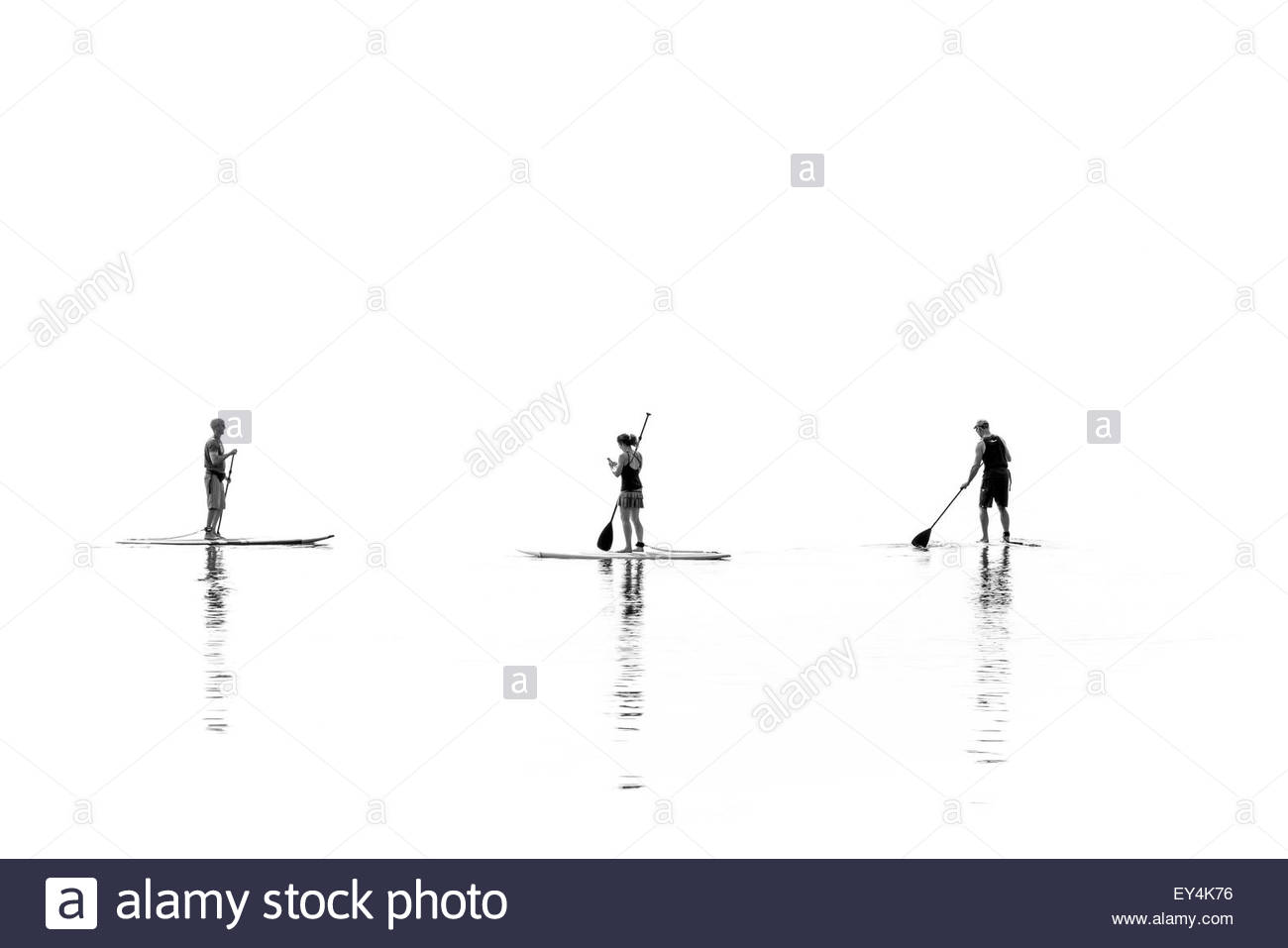 Stand up paddle boarders on a hot hazy summer day on Lake Ontario in Toronto Ontario Canada Stock Photo