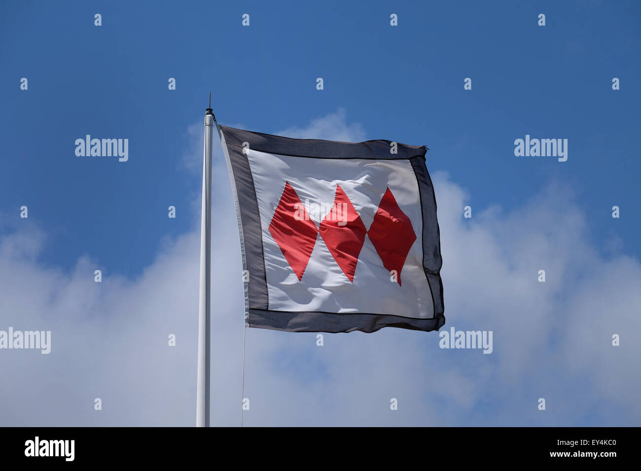 Three red diamonds Montagu coat of arms flag flying at Buckler's Hard on the Beaulieu Estate - Stock Image