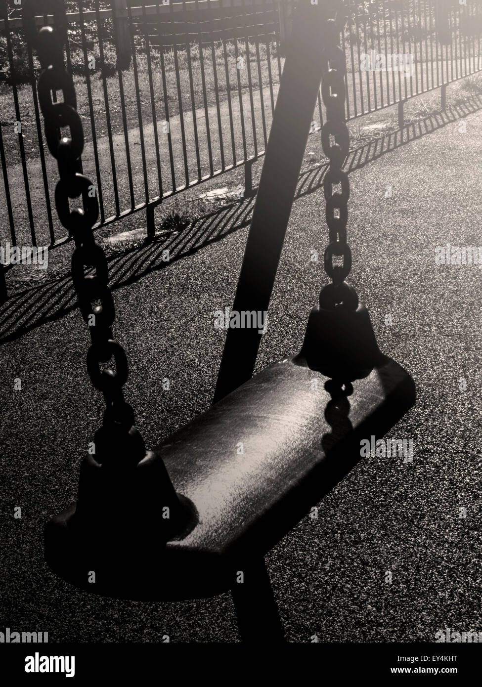 Swing in sun glare (empty) - Stock Image