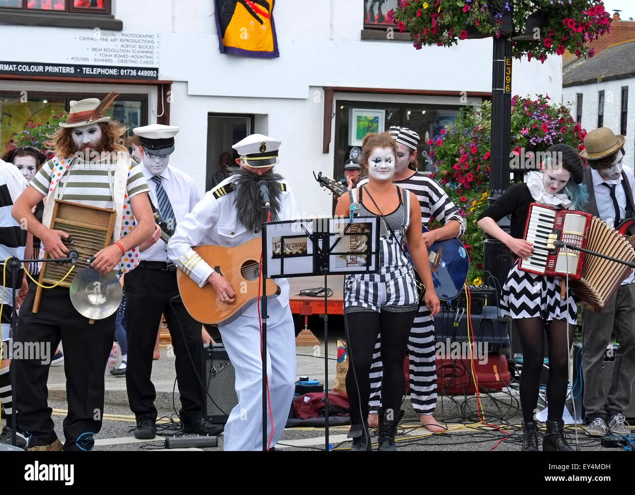 The Roustabouts Gypsy Cabaret band performing on Lafrowda Day in St.Just, Cornwall, UK - Stock Image