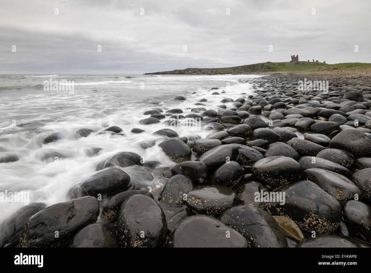 Dunstanburgh Castle on the coast of Northumberland in northern England - Stock Image
