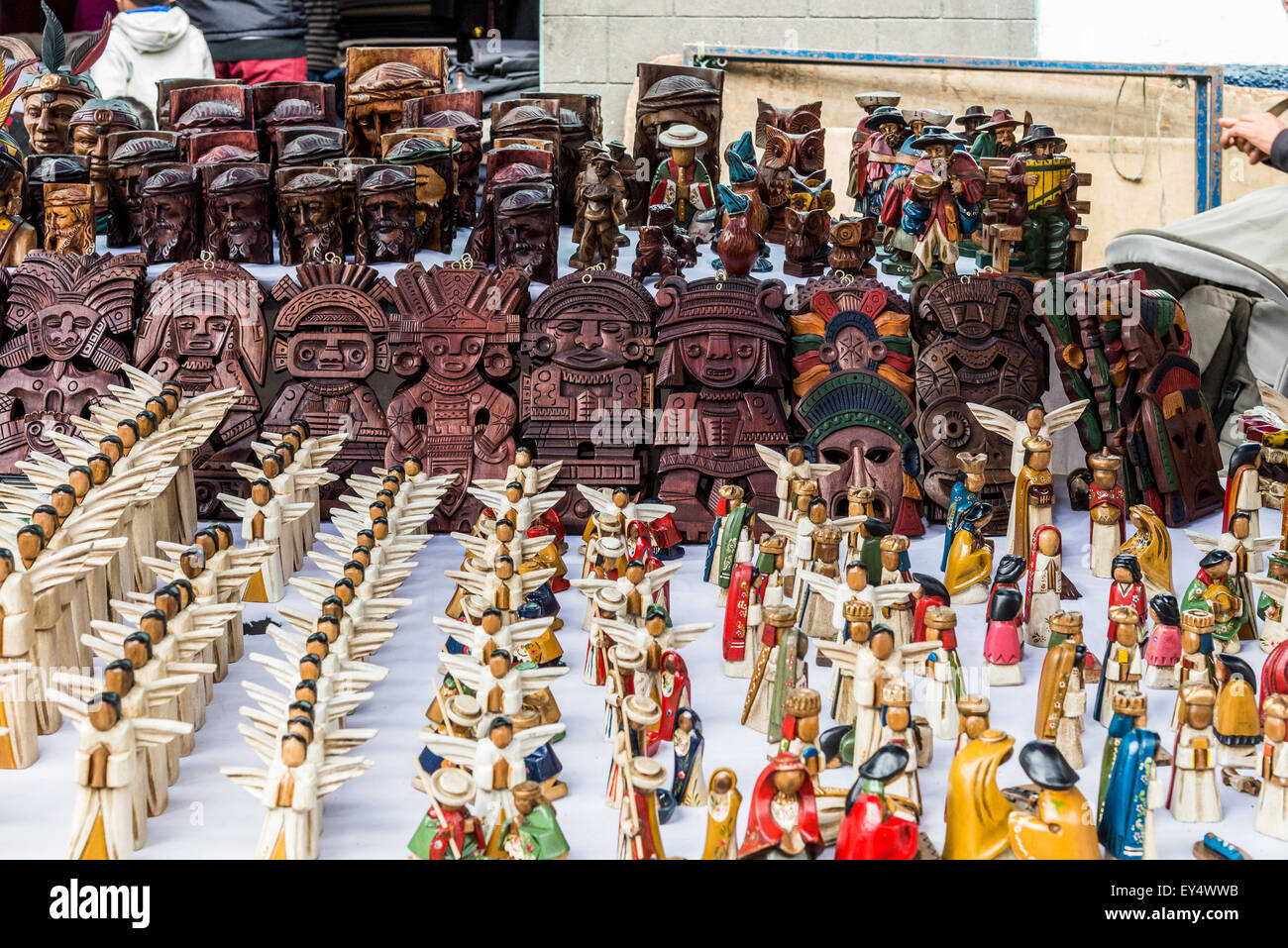 Hand-crafted figurines for sale at local market. Otavalo, Ecuador. - Stock Image