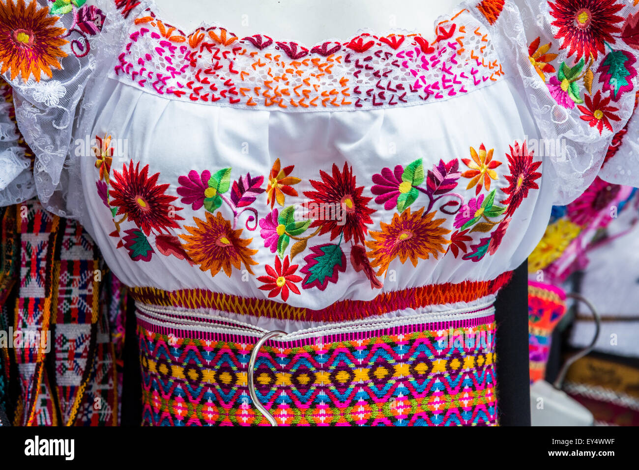 Colorfully embroiled lady's dress of traditional Andean style. Otavalo, Ecuador. - Stock Image