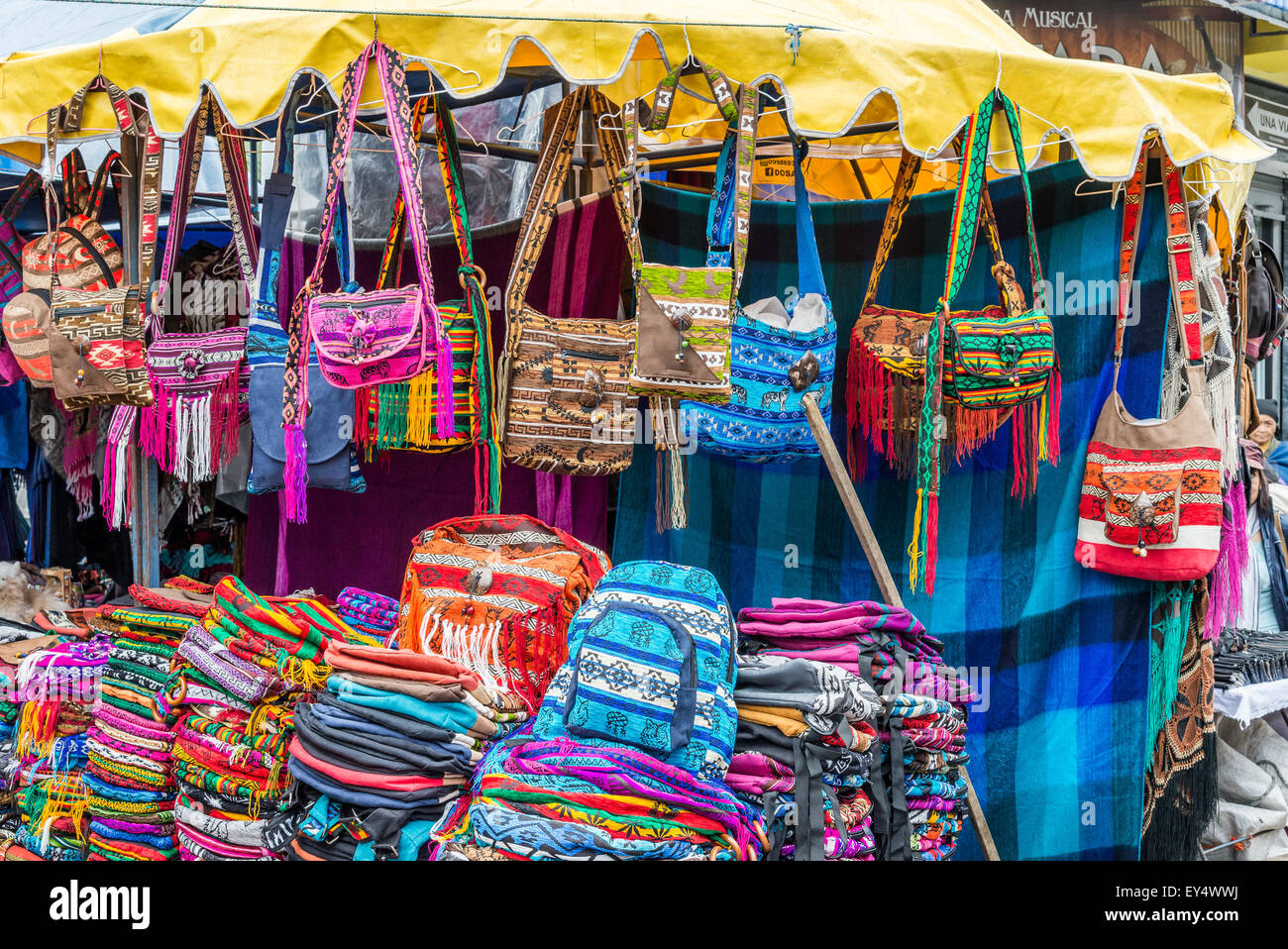 Colorful hand-crafted purses and bags for sale at local market. Otavalo, Ecuador. - Stock Image
