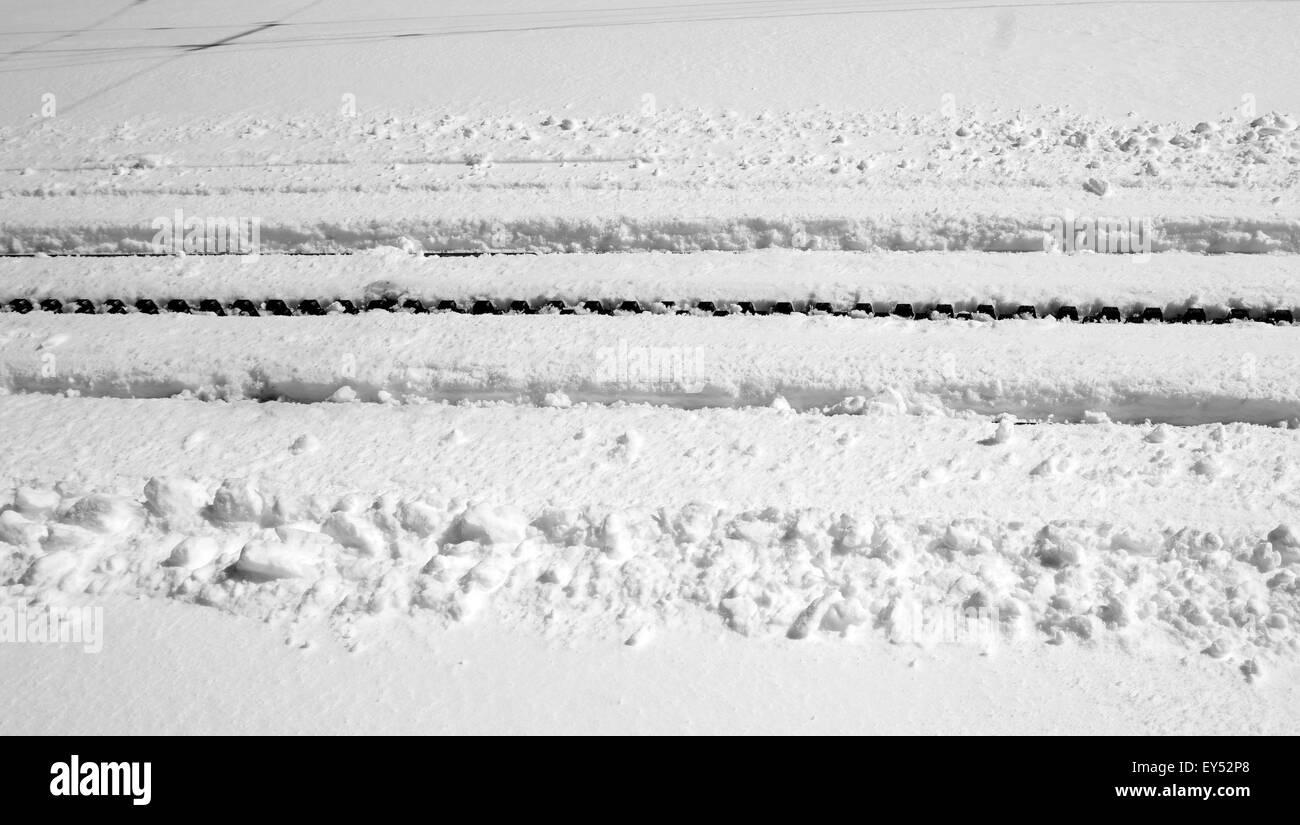 railway track cover with snow, zermatt, switzerland - Stock Image