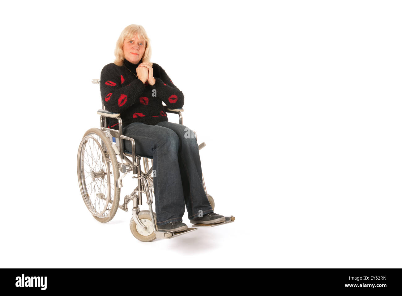 Mature woman in wheelchair isolated over white background - Stock Image