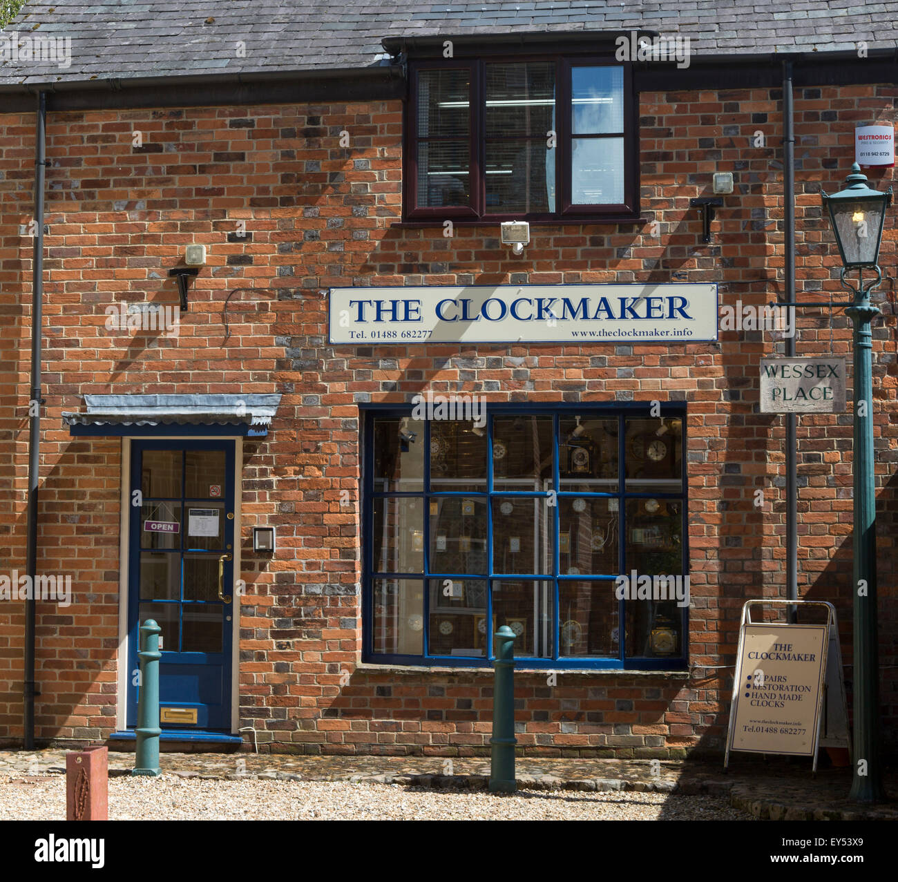 Specialist clockmaker shop, Hungerford, Berkshire, England, UK - Stock Image