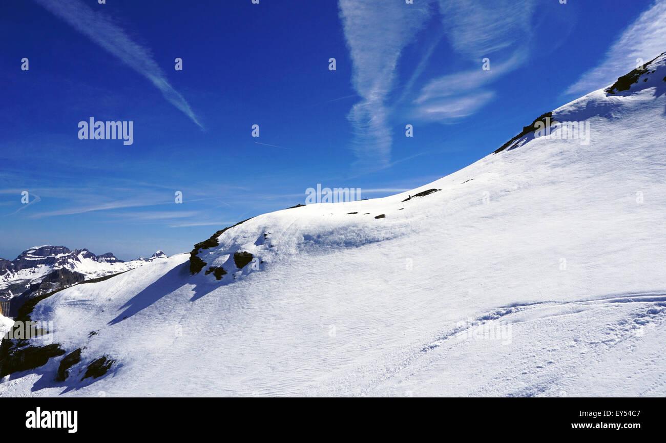 Titlis snow mountains white and vivid blue sky, Swiss - Stock Image