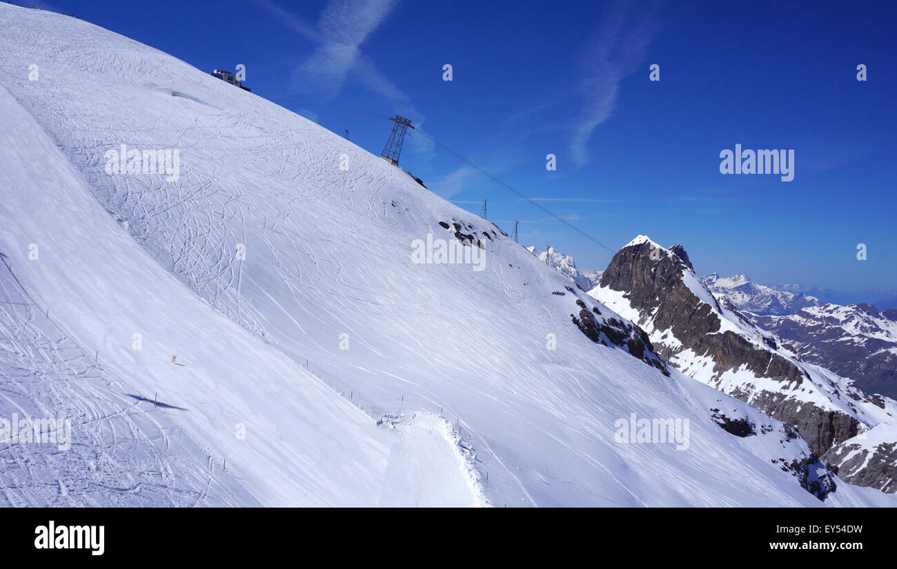angled view of snow mountains titlis and cable car, Engelberg, Switzerland - Stock Image
