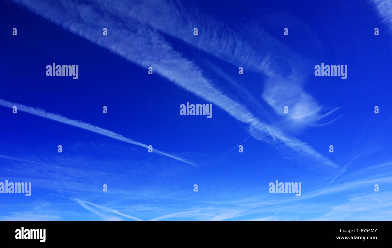 vivid blue sky and clouds background - Stock Image