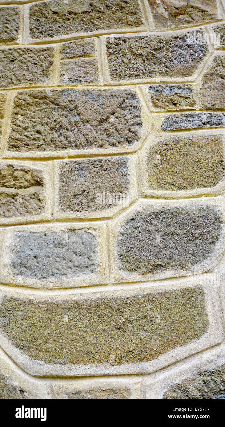 rough wall stone material close up pattern vertical - Stock Image