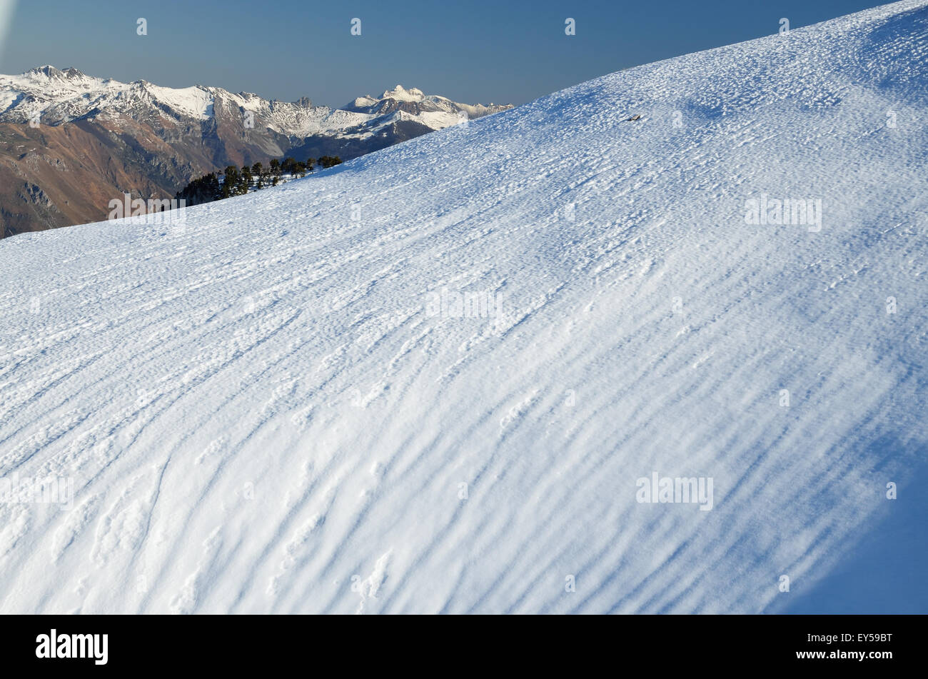 Steep snow downhill with traces - Stock Image