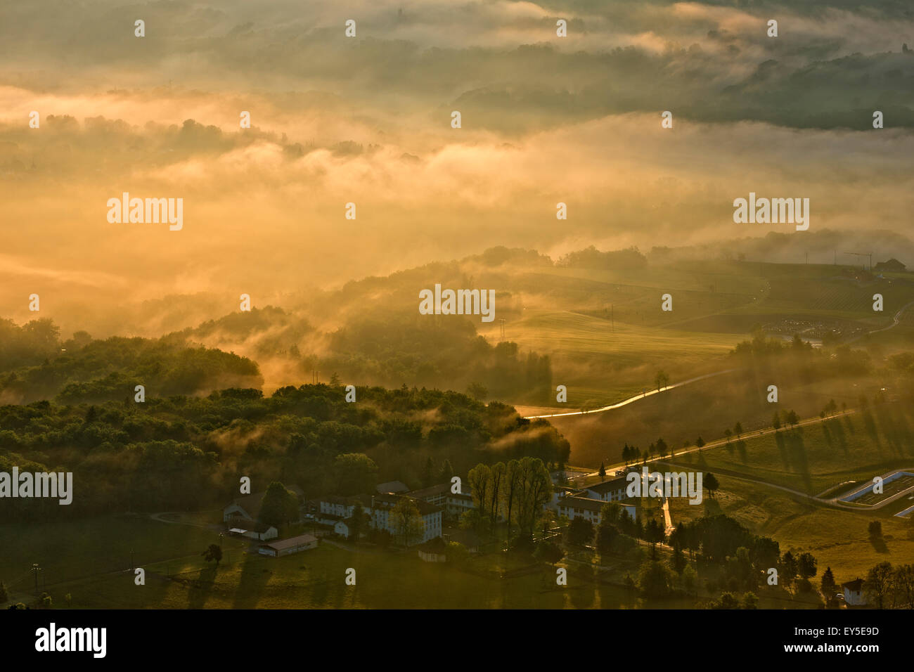 Mists of Savoyard countryside at dawn - France after a stormy night - Stock Image