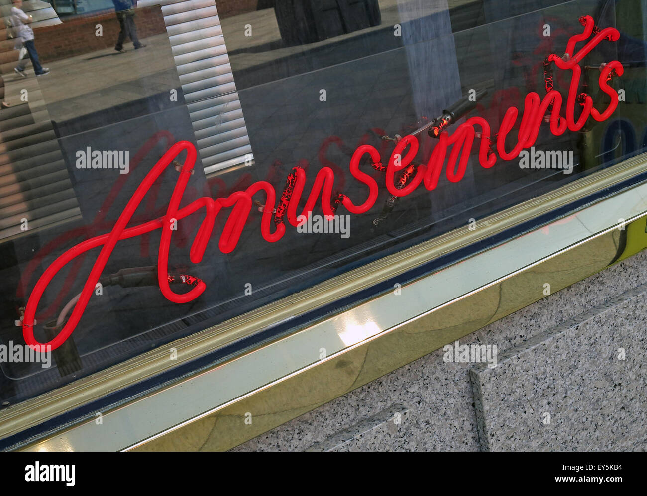 Red Neon Amusements sign in a window - Stock Image