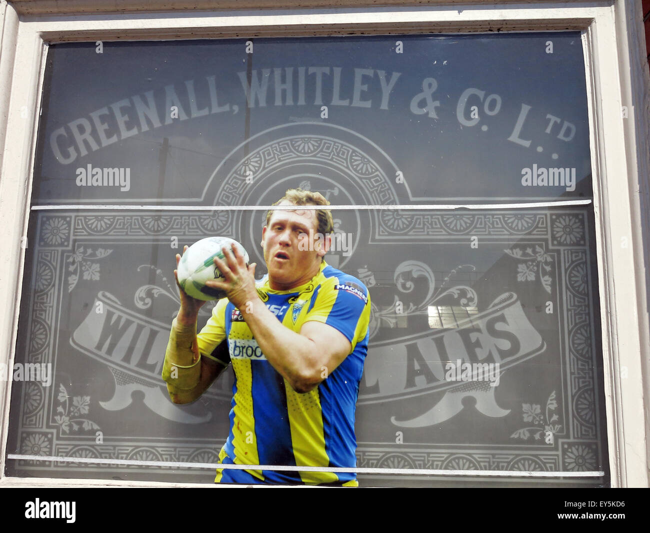 Greenall,Whitley,Wilderspool Ales,Rugby,Wire player in pub window - Stock Image