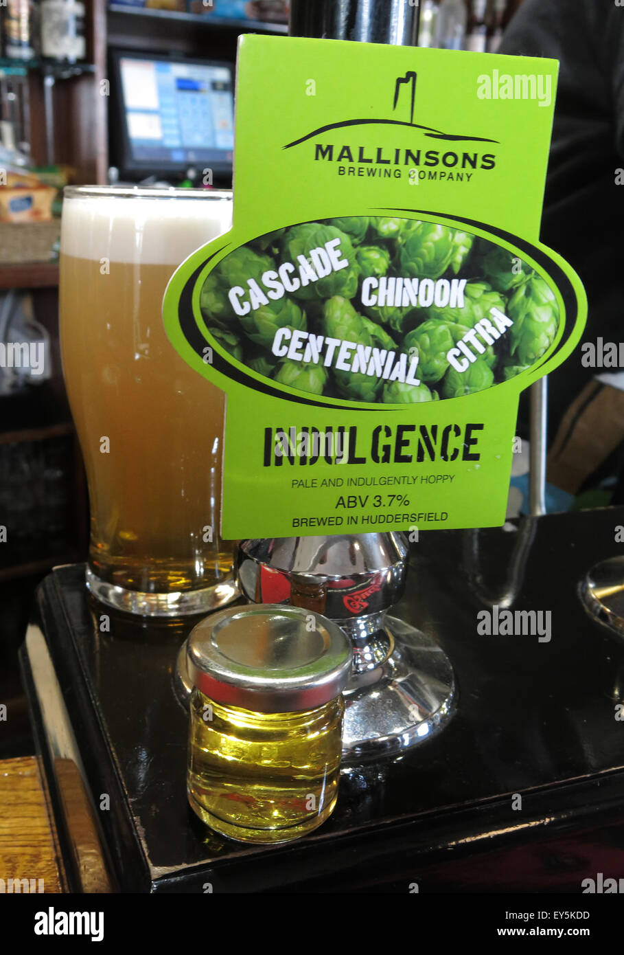 Mallinsons Indulgence,Real Ale with taster bottle to show colour - Stock Image