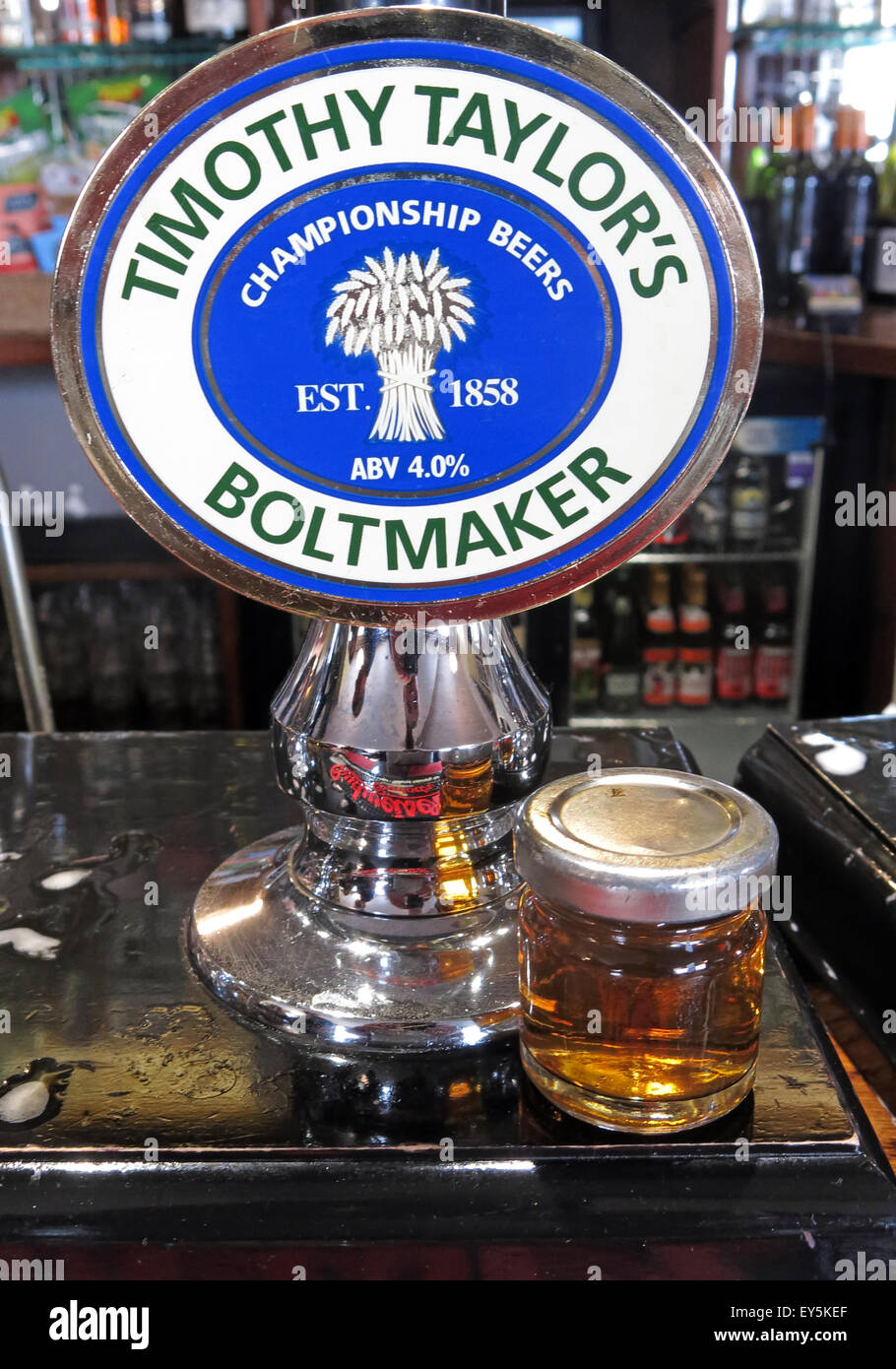 A pump and sample of Timothy Taylor Boltmaker Bitter, in a bar, Yorkshire, England, UK Stock Photo