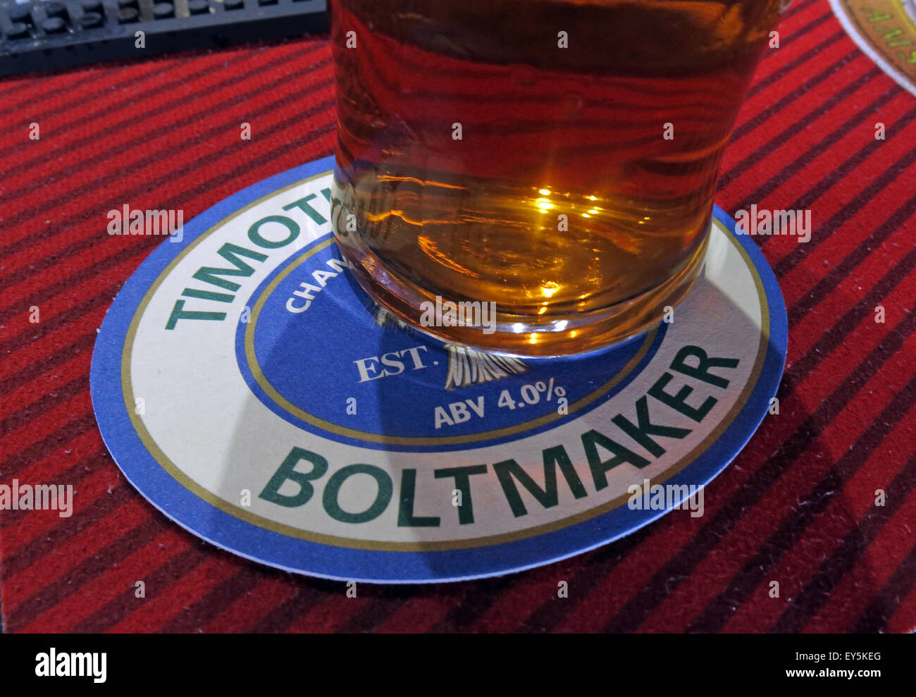 A pint of Timothy Taylor Boltmaker Bitter, in a bar, Yorkshire, England, UK on a beermat Stock Photo