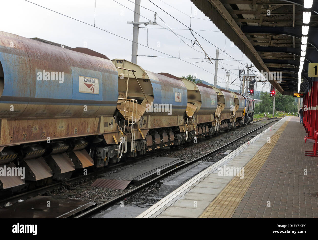 Railtrack railway Freight wagons at a red signal at Warrington Bank Quay Station, Cheshire, England, UK - Stock Image