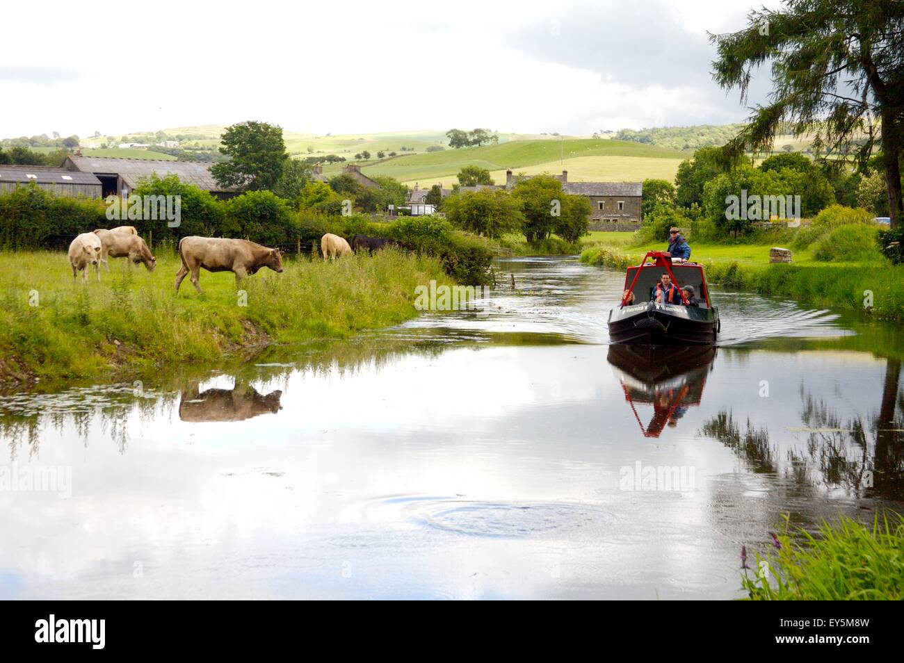 Lancaster Canal Trust trip boat near Crooklands on 'Northern Reaches' of Lancaster Canal, Cumbria, England - Stock Image