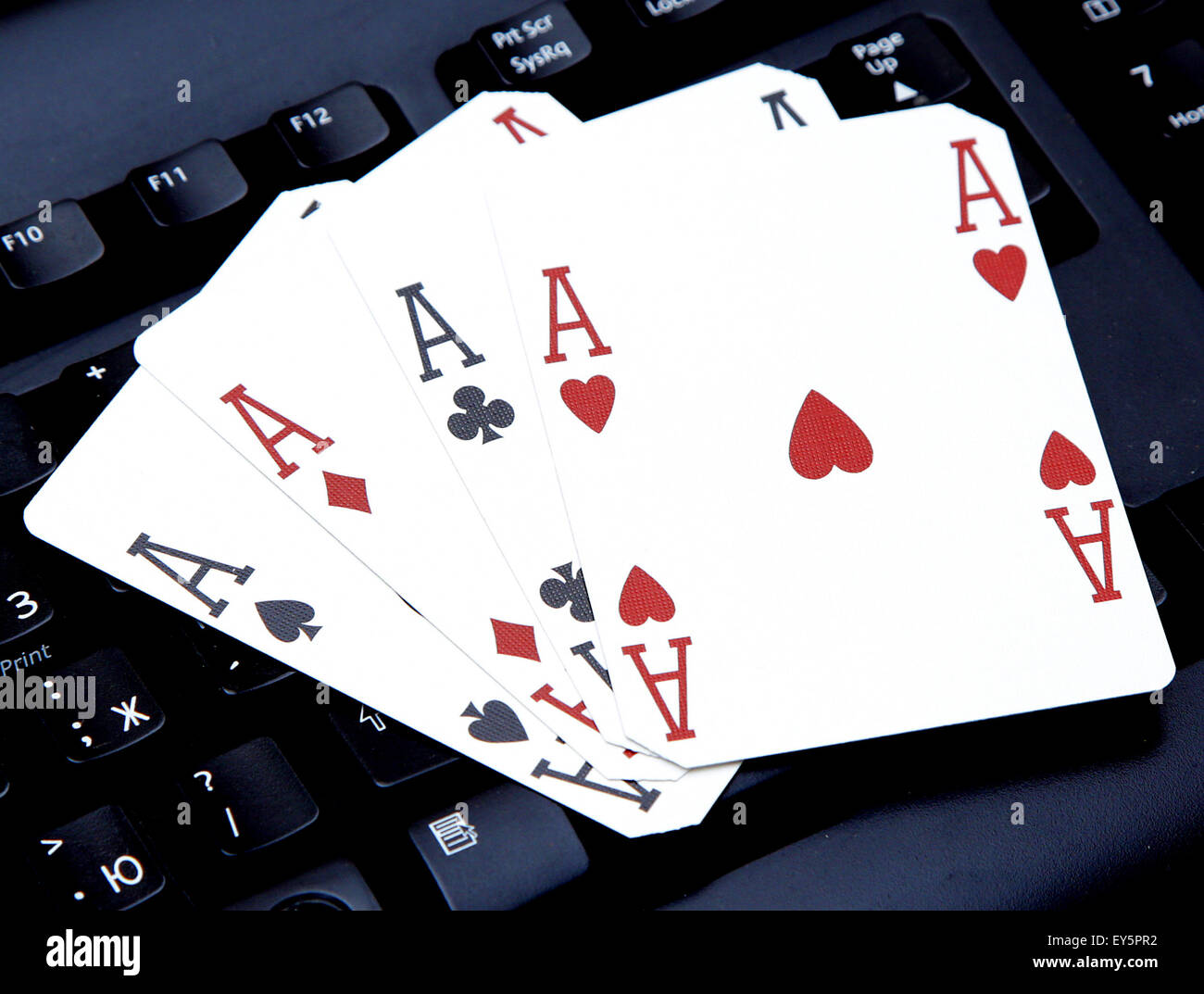 internet casino poker four of kind aces cards comdination hearts on keyboard - Stock Image