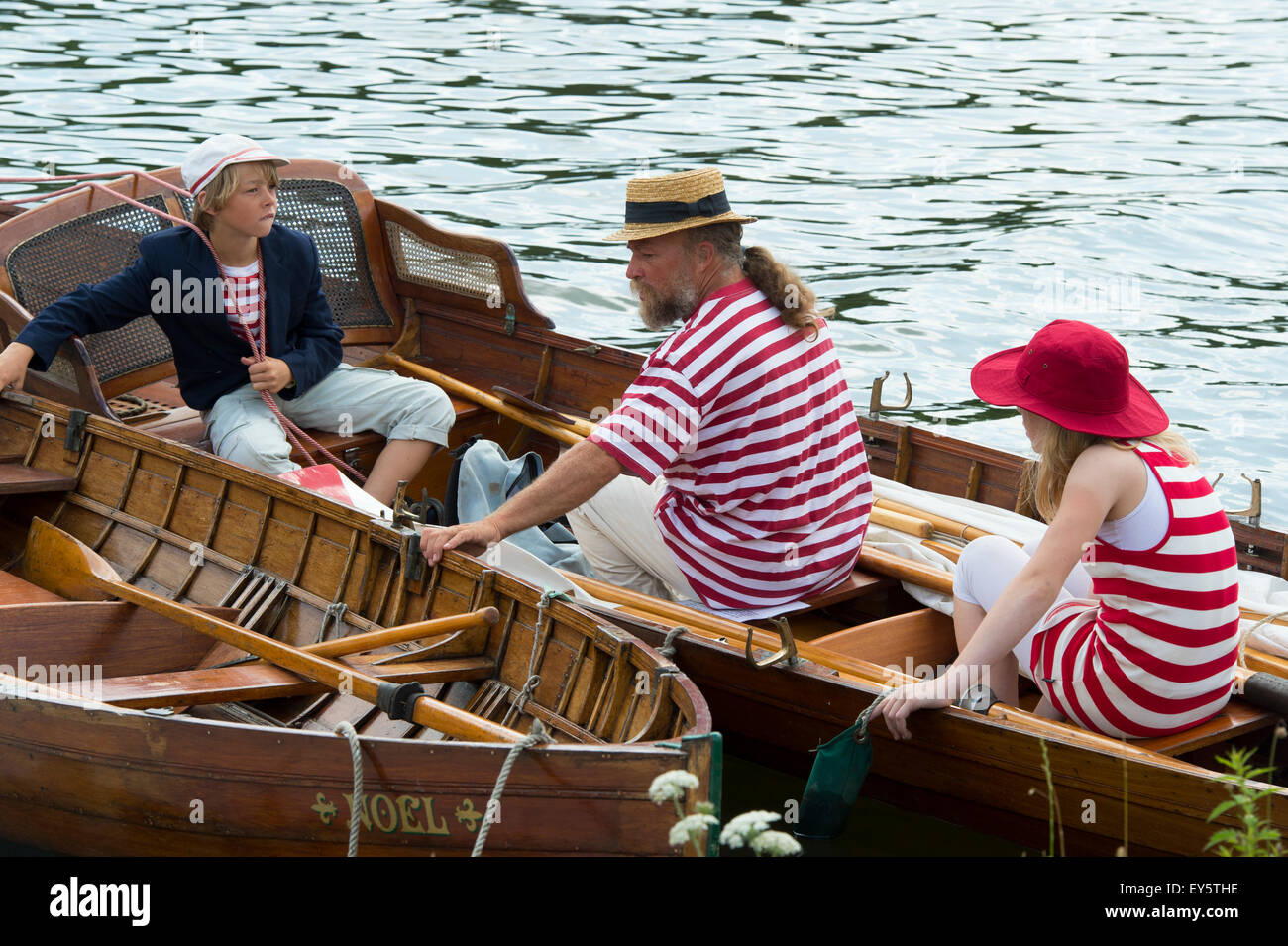 Family casting off in a old wooden rowing boat at the Thames Traditional Boat Festival, Henley On Thames, Oxfordshire, Stock Photo