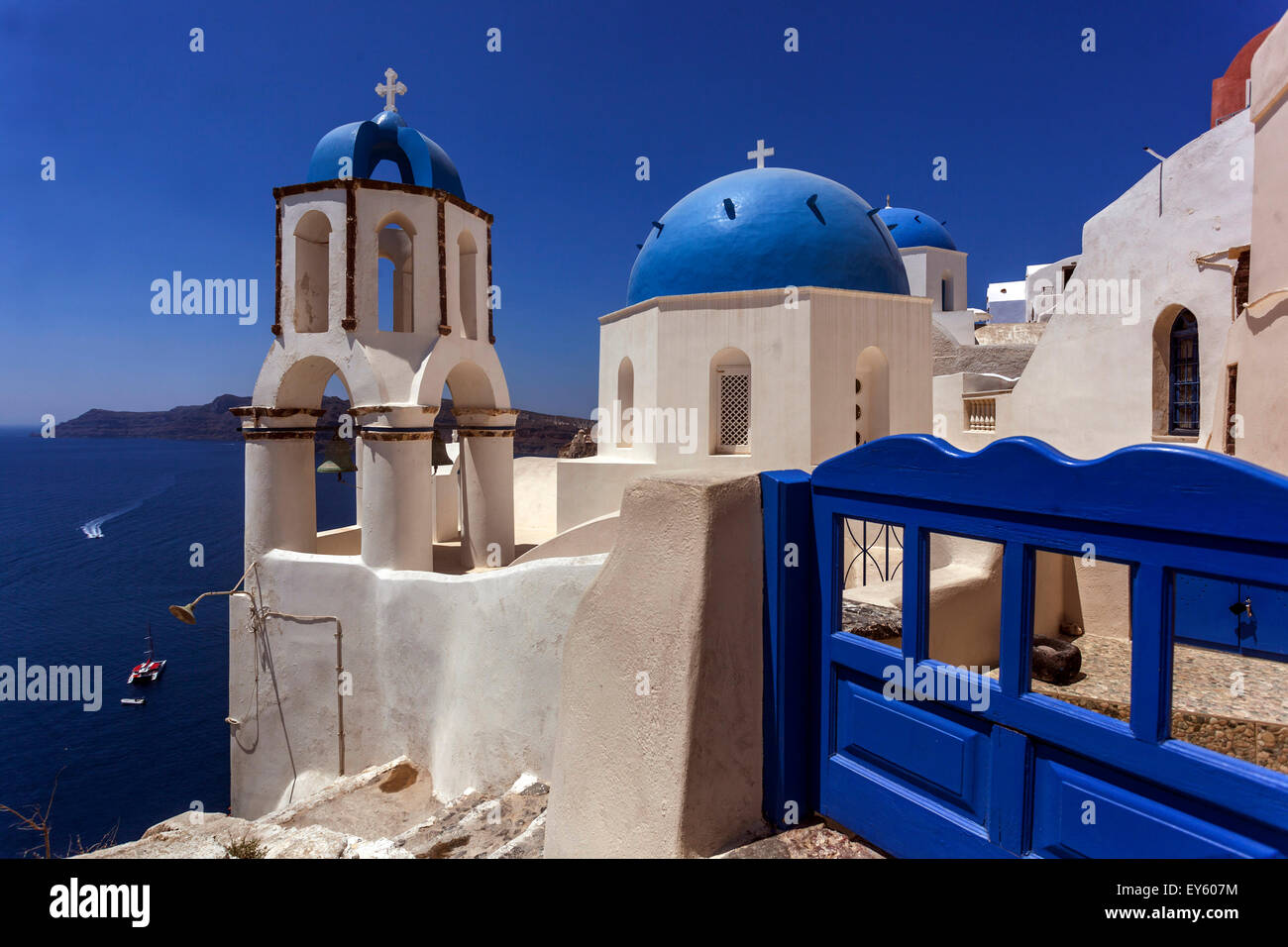 View to the blue domed churches in the Oia village by the cliff, Santorini, Cyclades Islands, Greek Islands, Greece, Stock Photo