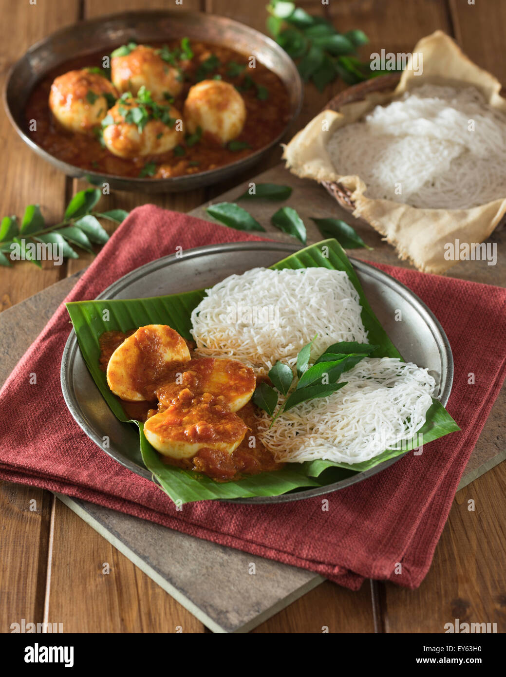 Egg curry and string hoppers. Sri Lanka and South India Food - Stock Image
