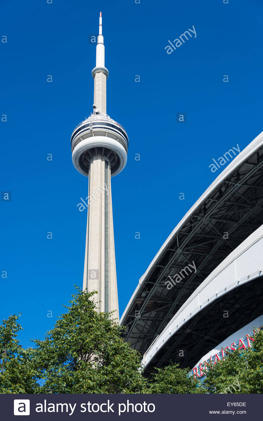 CN Tower with Renaissance Hotel against clear blue sky. Renaissance Hotel is a luxury and modern hotel built into - Stock Image