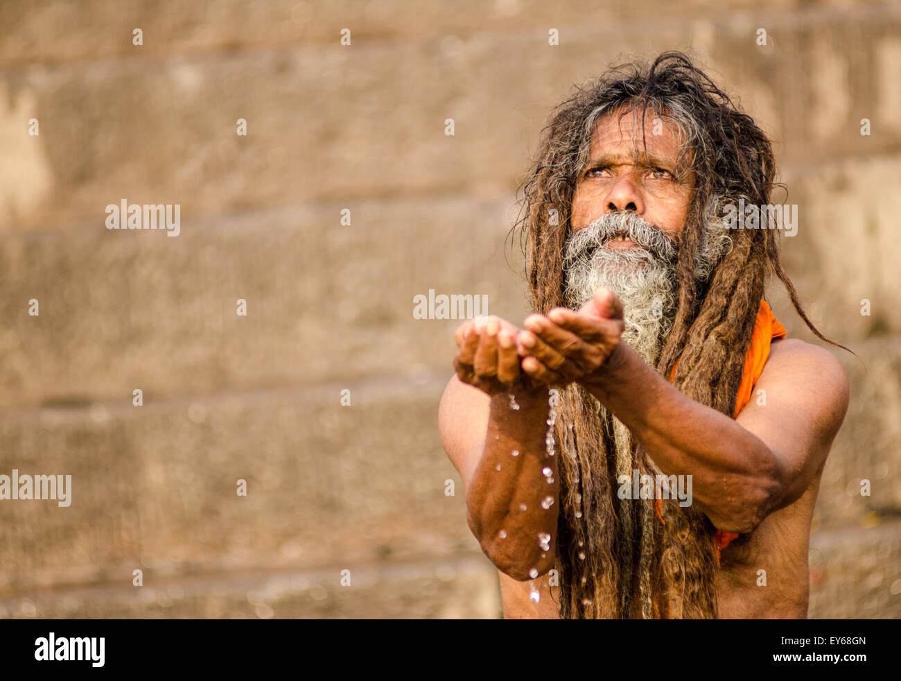 Sadhu praying at Ganges - Stock Image