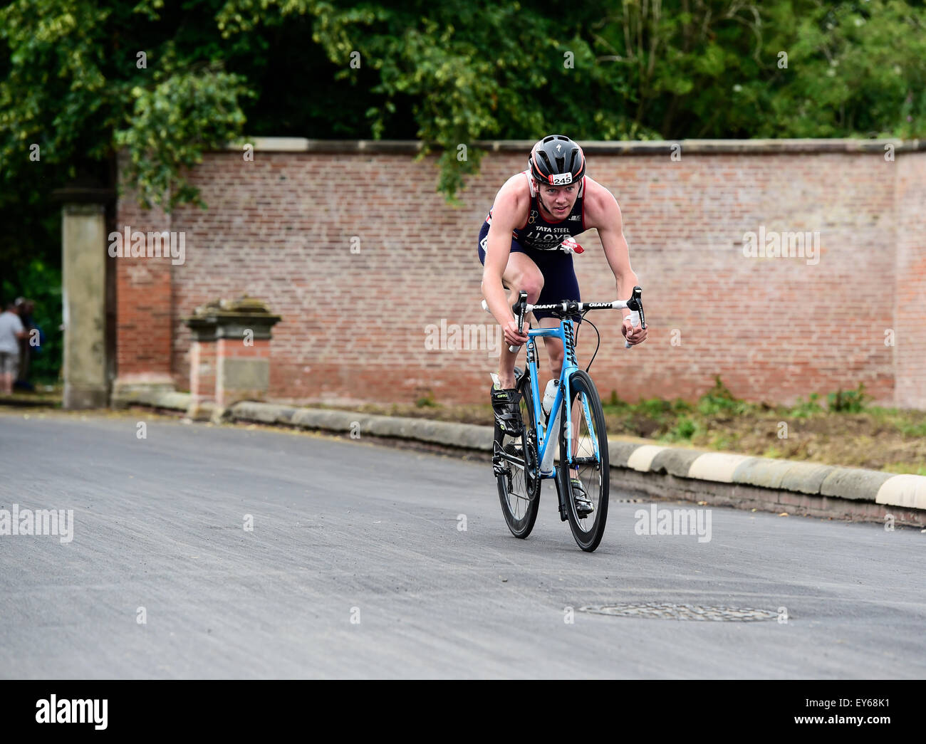 Team GBR Triathlete Liam Lloyd on the bike split during the 2015 Jenson Button Trust Triathlon in aid of Cancer - Stock Image