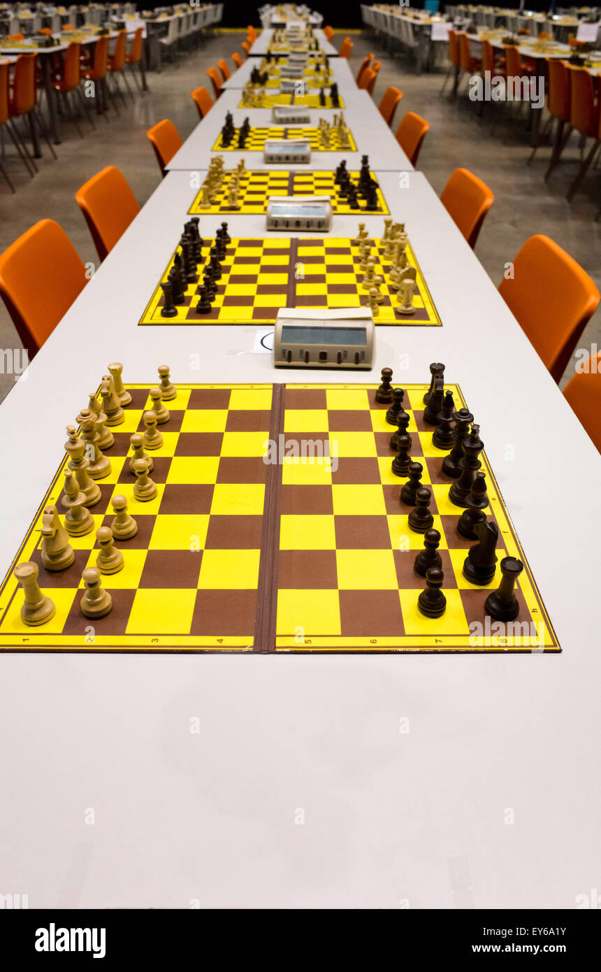 rows of chessboards in a tournament hall - Stock Image