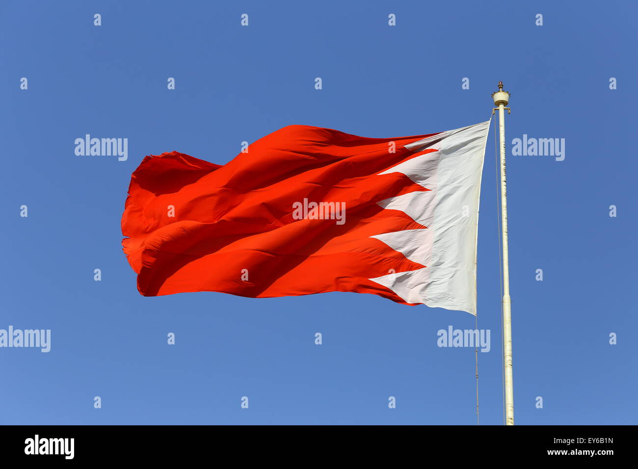 Bahrain flag blowing in the wind on a sunny day - Stock Image