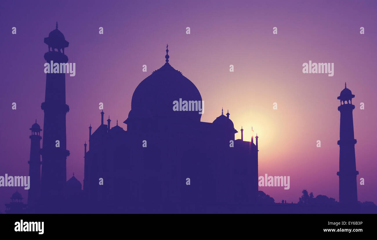 Vintage retro toned silhouette of Taj Mahal at sunrise, India. - Stock Image