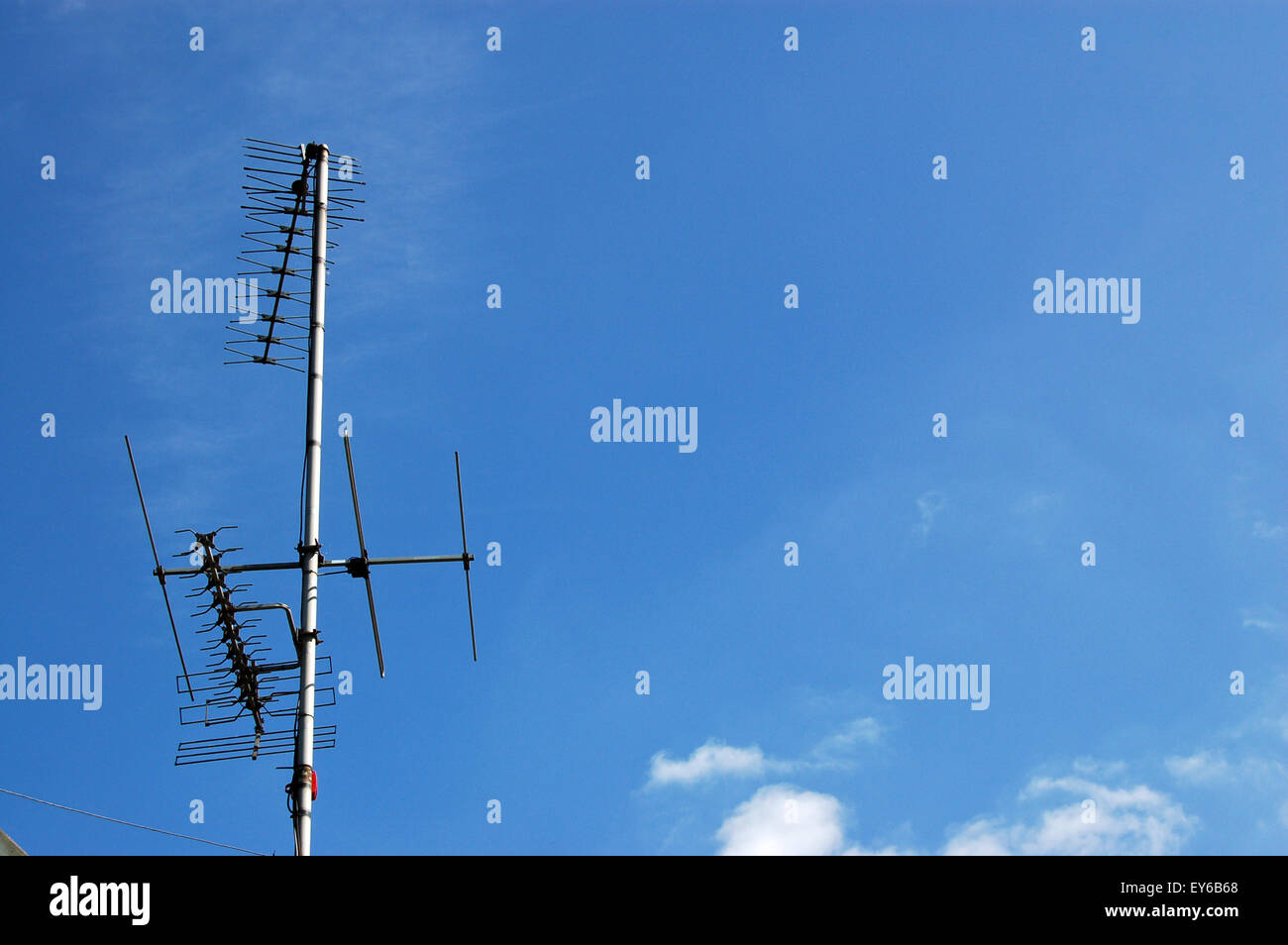 Yagi Stock Photos Images Alamy Tv Antenna Wiring Diagram A Collection Of Television Aerials On Roof Against Blue Sky Sunny