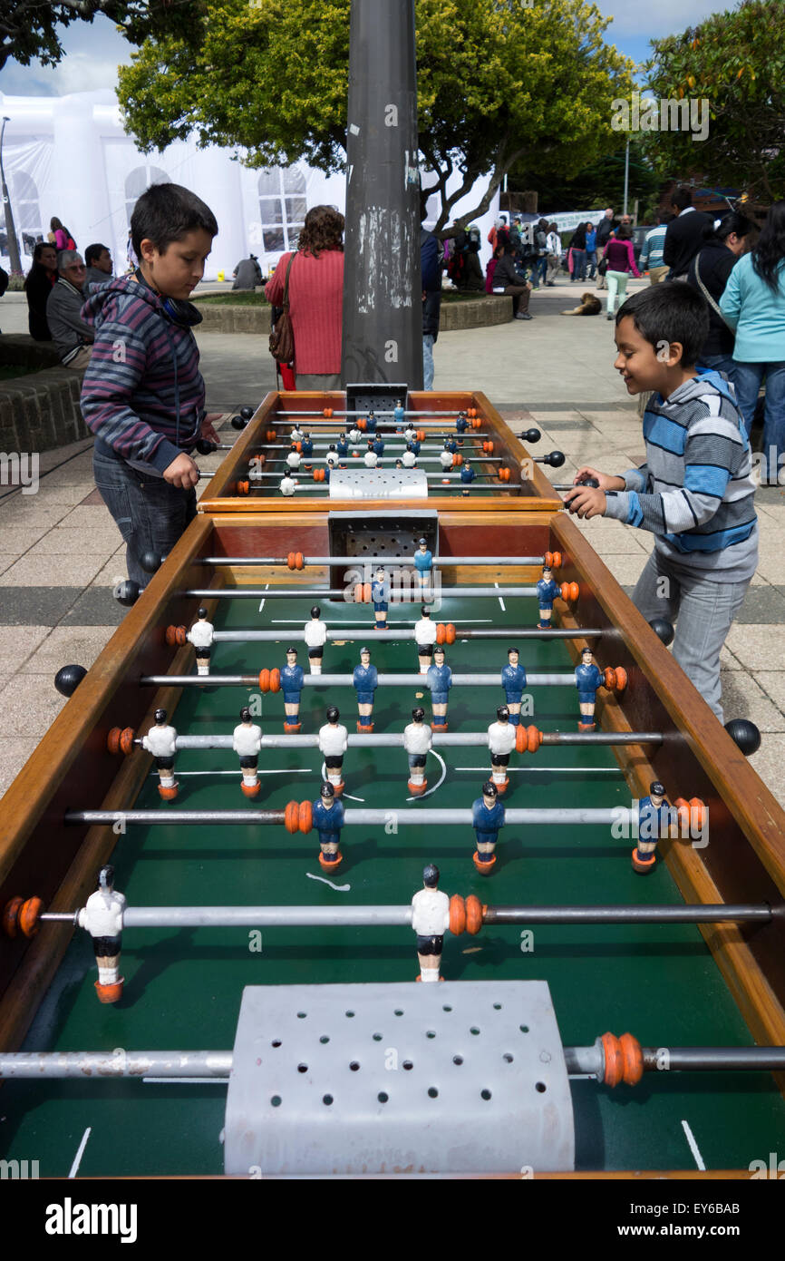 Kids playing table football. Ancud. Chiloé Island. Chile - Stock Image