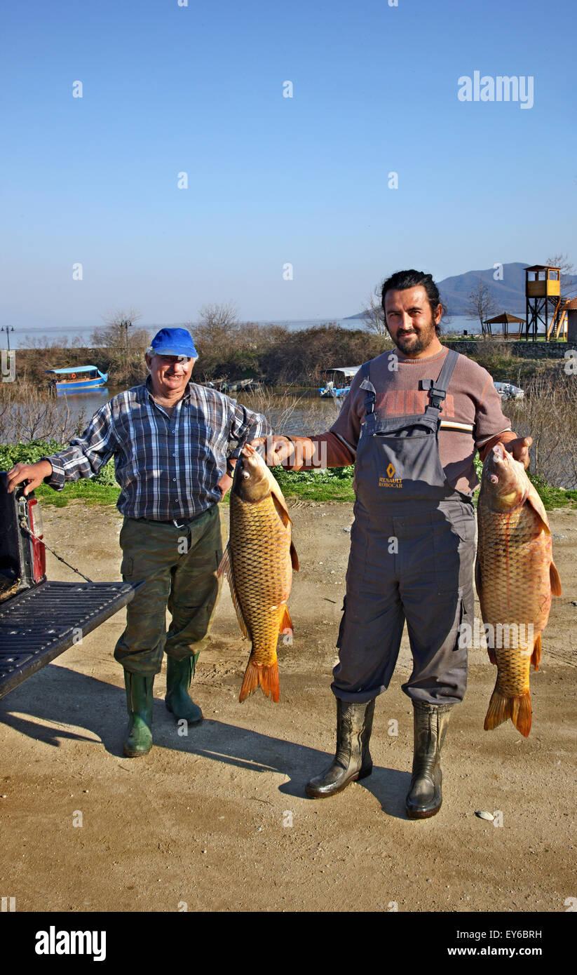 Fishermen at the small port of Kerkini village, Kerkini lake, Serres, Macedonia, Greece - Stock Image