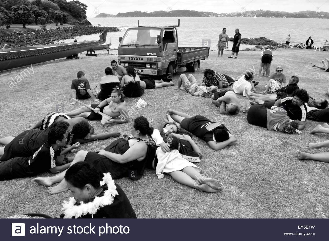 Members of a waka (traditional Maori canoe) crew rest after participating in  Waitangi Day annual commemorations Stock Photo