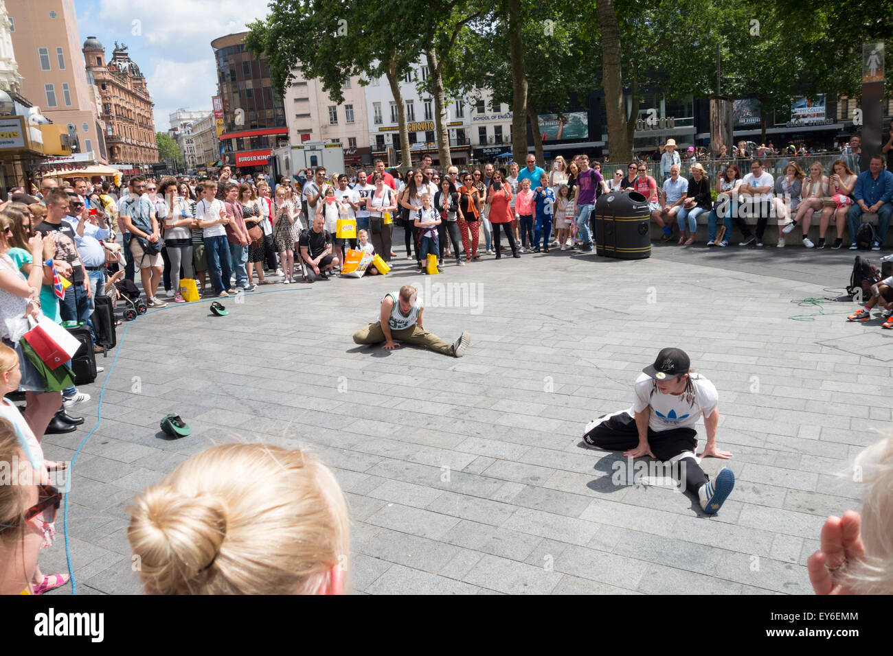 Street entertainers dancing to an audience in Leicester Square, London England UK - Stock Image