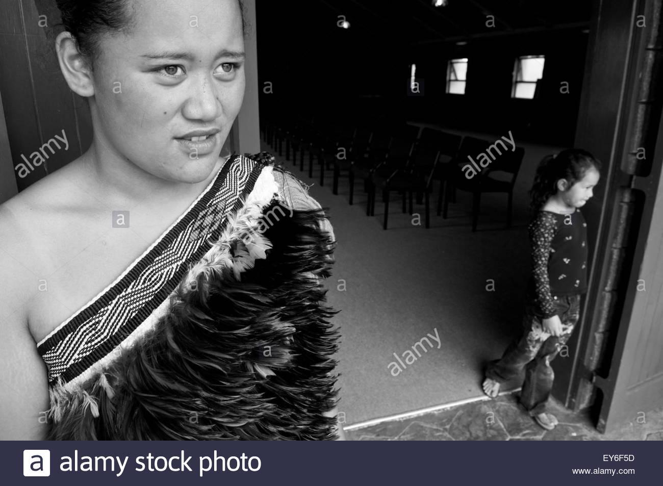Two Maori girls at the entrance of Tamatea Marae in Motuti, Northland, North Island, New Zealand - Stock Image
