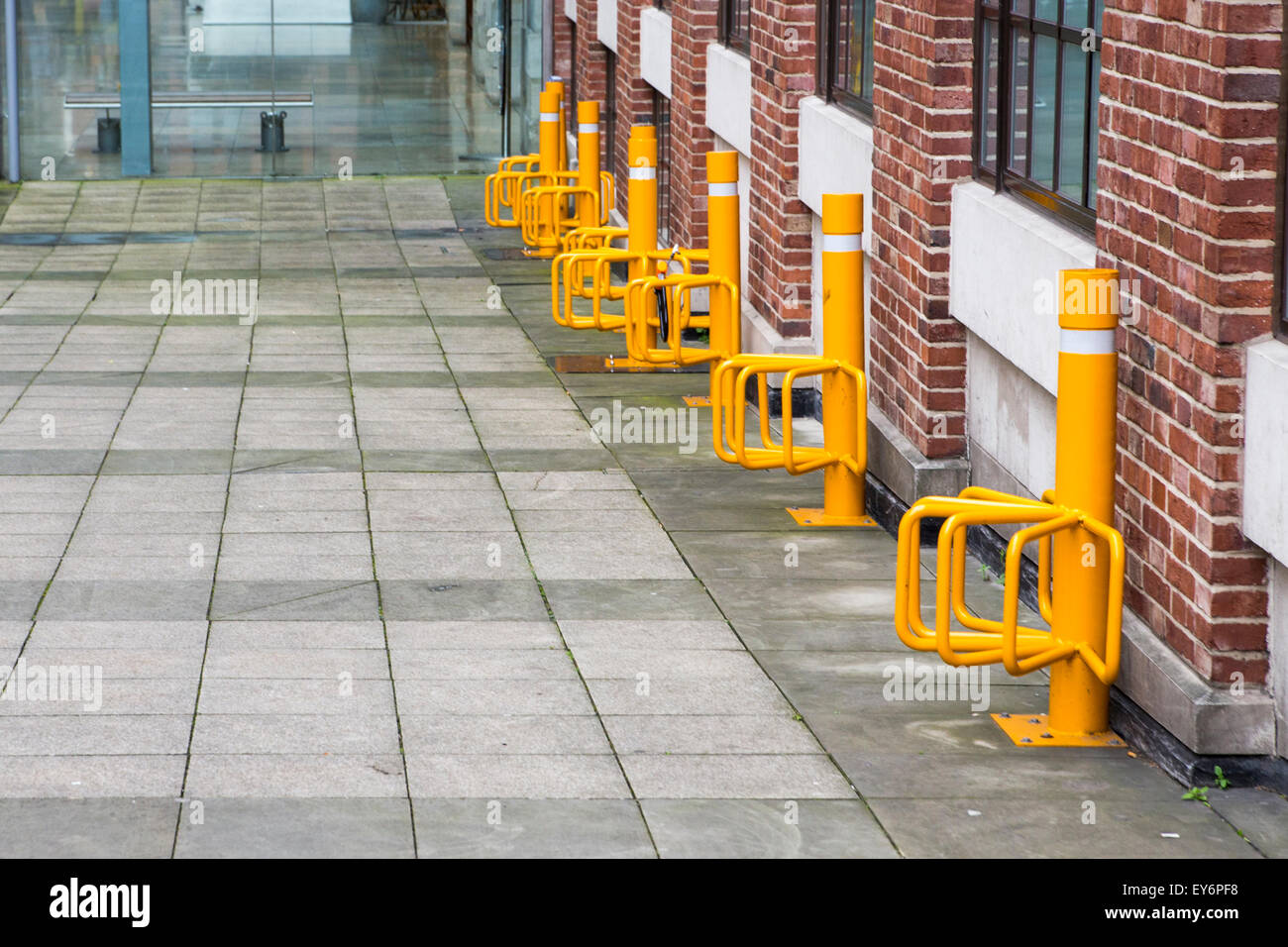 BHZ Yellow bicycle parking in Leeds city centre, UK. - Stock Image