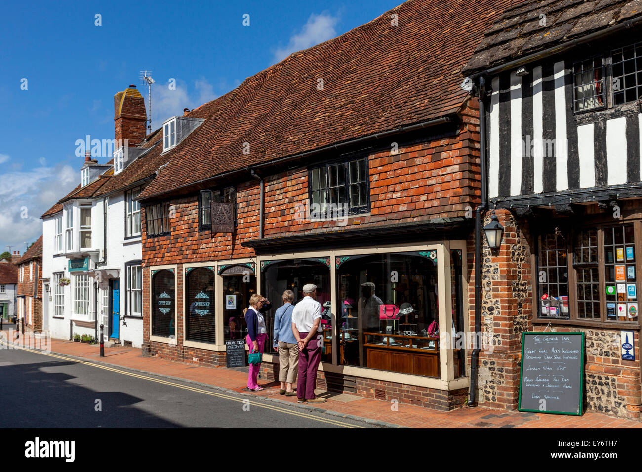 Visitors Looking At The Apiary Clothes & Coffee Shop,  Alfriston, Sussex, UK - Stock Image