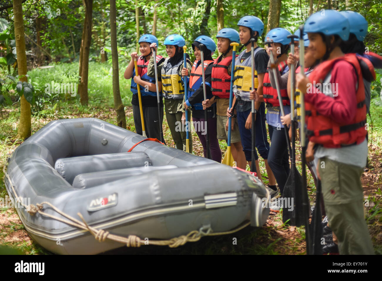 Teenagers prepare for white water rafting training. - Stock Image