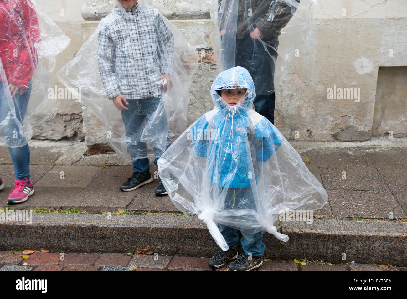 A rainy day in Tallinn, Estonia's Old Town, with ponchos for sale in the souvenir shops. - Stock Image