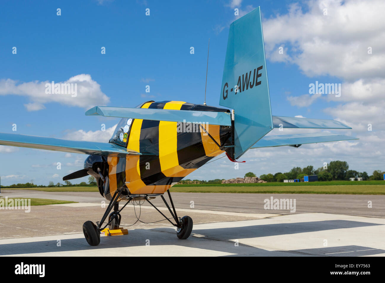 Slingsby Nipper T66, reg. G-AWJE,  at Breighton, painted as a bumble-bee - Stock Image